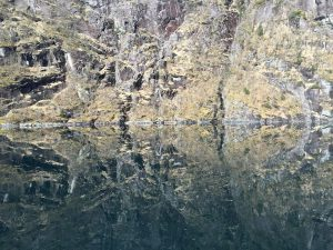 Mirror image - cliffs reflected in the water