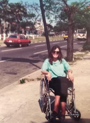 Author is sitting in a wheelchair on the pavement in Sucre, Bolivia