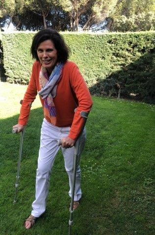 Susannah Grant walks up and down her garden on crutches