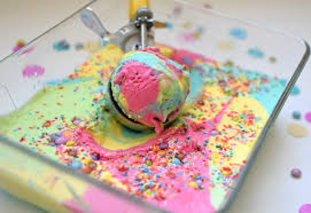 Rainbow coloured ice cream scoop